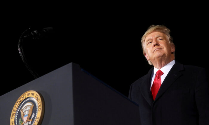 President Donald Trump addresses a campaign rally  on the eve of the run-off election to decide both of Georgia's Senate seats in Dalton, Ga., on Jan. 4, 2021. (Leah Millis/Reuters)