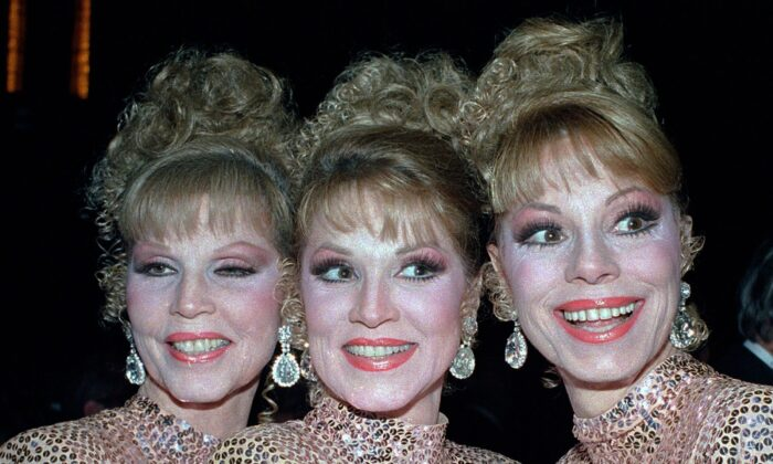 In this Oct. 10, 1986 file photo, The McGuire Sisters, from left, Christine, Phyllis, and Dorothy, pose outside Radio City Music Hall in New York (Ed Bailey /AP Photo, File)