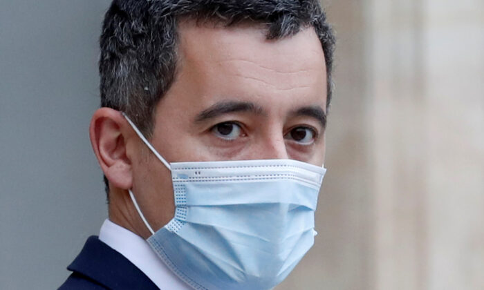 French Interior Minister Gerald Darmanin, wearing a protective face mask, leaves following the weekly cabinet meeting at the Elysee Palace in Paris, on Dec. 16, 2020. (Gonzalo Fuentes/Reuters)