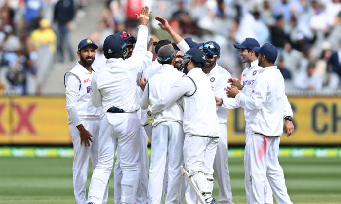 India cricket players celebrate wicket during day three of the Second Test match against Australia at Melbourne Cricket Ground in Melbourne, Australia on Dec. 28, 2020. (Quinn Rooney/Getty Images)