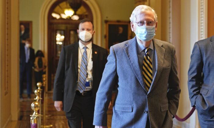 Senate Majority Leader Mitch McConnell (R-Ky.) walks back to his office on Capitol Hill in Washington, on Dec. 30, 2020. (Susan Walsh/AP Photo)