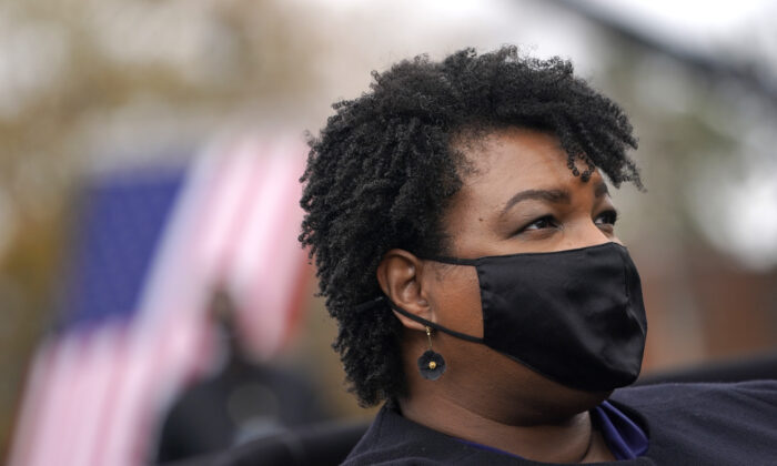 Stacey Abrams looks on during a campaign rally with Democratic presidential nominee Joe Biden in Atlanta, Ga., on Dec. 15, 2020. (Drew Angerer/Getty Images)