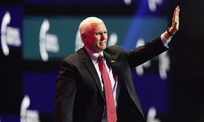 Then Vice President Mike Pence waves as he walks off the stage after speaking at the Turning Point USA Student Action Summit in West Palm Beach, Fla., on Dec. 22, 2020. (Lynne Sladky/AP Photo)