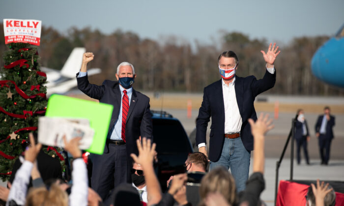 Vice President Mike Pence and Sen. David Purdue (R-GA) wave to the crowd during a rally in support of Purdue and Sen. Kelly Loeffler (R-GA) in Augusta, Georgia, on Dec. 10, 2020. (Jessica McGowan/Getty Images)