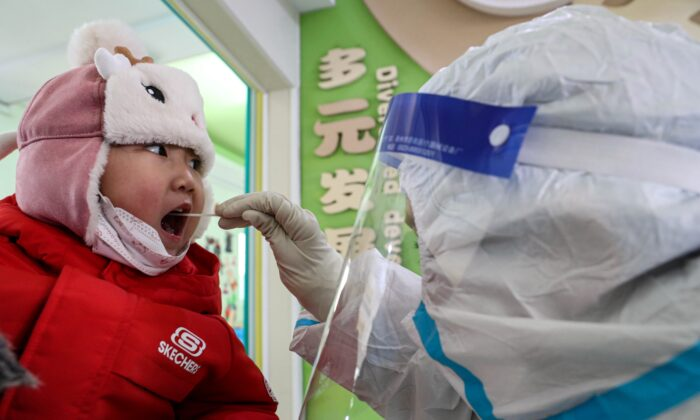 A child takes a COVID-19 swab test in Shenyang, China on Jan. 1, 2021. (STR/AFP via Getty Images)