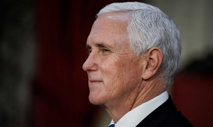 Vice President Mike Pence finishes a swearing-in ceremony for senators in the Old Senate Chamber at the Capitol in Washington on Jan. 3, 2021. (J. Scott Applewhite/Pool/AFP via Getty Images)