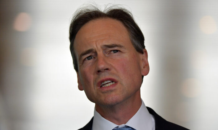 Minister for Health Greg Hunt addresses media during a doorstop in the Mural Hall at Parliament House in Canberra, Australia on Dec.8, 2020. (Sam Mooy/Getty Images)