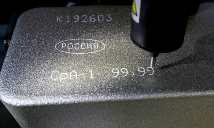 A machine engraves information on an ingot of 99.99 percent pure silver at the Krastsvetmet non-ferrous metals plant, one of the world's largest producers in the precious metals industry, in the Siberian city of Krasnoyarsk, Russia, on Oct. 24, 2016. (Ilya Naymushin/Reuters)