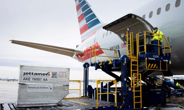 An American Airlines cargo plane is unloaded at Philadelphia International Airport in Philadelphia, on Dec. 4, 2020. (Reuters/Rachel Wisniewski/File Photo)