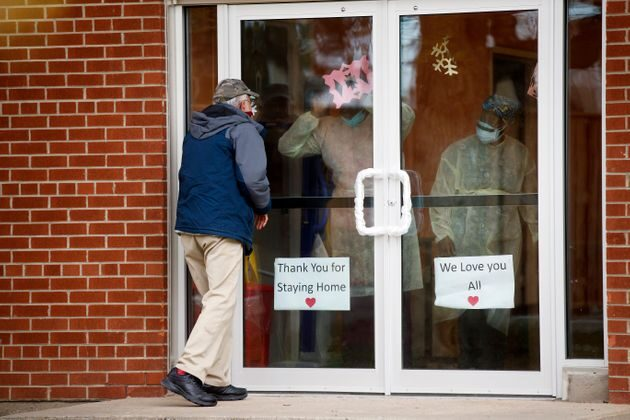 A man attempts to visit a family member at a long-term care home in Toronto on May 10, 2020. (Cole Burston/Getty Images)
