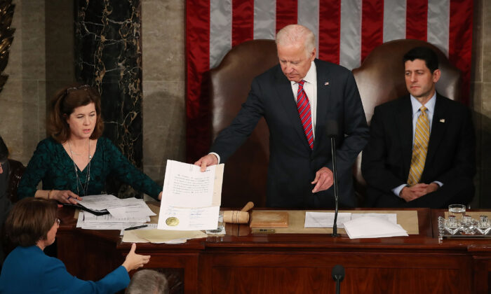 Then-Vice President Joe Biden (C), presides over the counting of the electoral votes from the 2016 presidential election during a joint session of Congress, in Washington on Jan. 6, 2017. (Mark Wilson/Getty Images)