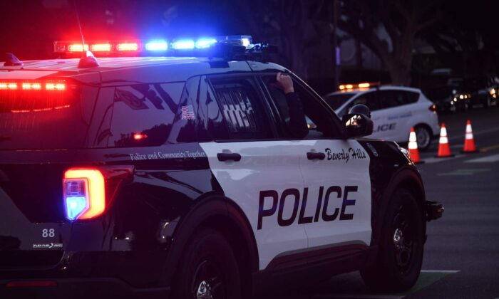Police officers patrol in their car in Beverly Hills, Los Angeles, on Nov. 1, 2020. (Chris Delmas/AFP via Getty Images)