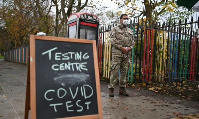 A chalk board sign is seen on the street outside a testing centre staffed by British Army soldiers in Liverpool, on Nov. 10, 2020, during a city-wide mass testing pilot operation.(Oli Scarff/AFP via Getty Images)