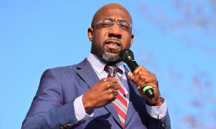 Georgia Democratic Senate candidate Rev. Raphael Warnock speaks at an Augusta canvass launch block party in Hepzibah, Ga., on Jan. 4, 2021. (Michael M. Santiago/Getty Images)