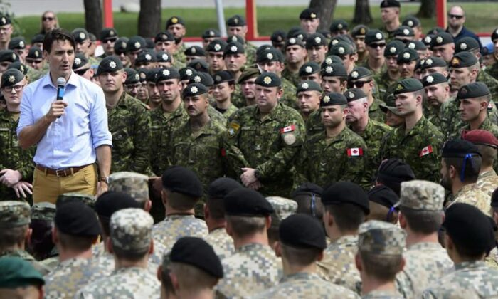 Prime Minister Justin Trudeau addresses the troops at Adazi Military Base in Kadaga, Latvia, on July 10, 2018. (The Canadian Press/Sean Kilpatrick)