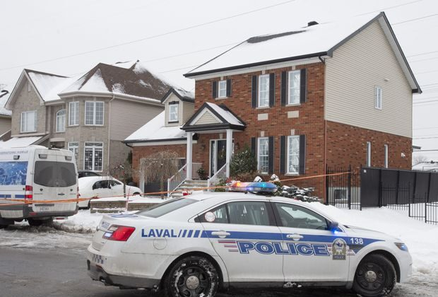 Police on scene at a home in Laval, Que., on Jan. 4, 2021, where a Quebec girl was found  in cardiorespiratory arrest and later pronounced dead. (The Canadian Press/Ryan Remiorz)