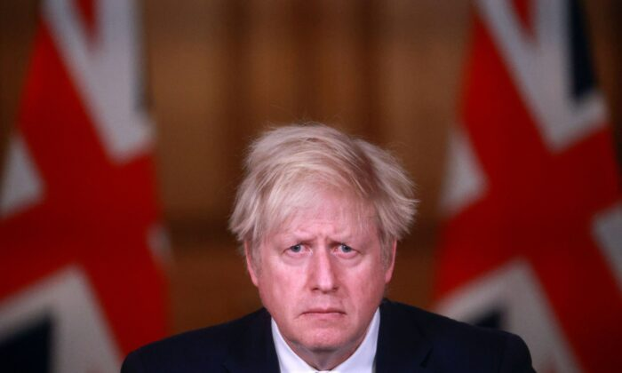 Britain's Prime Minister Boris Johnson takes part in a virtual press conference inside 10 Downing Street in central London following the introduction of a nationwide coronavirus lockdown on Jan 5, 2021. (Hannah Mckay/Pool/AFP via Getty Images)