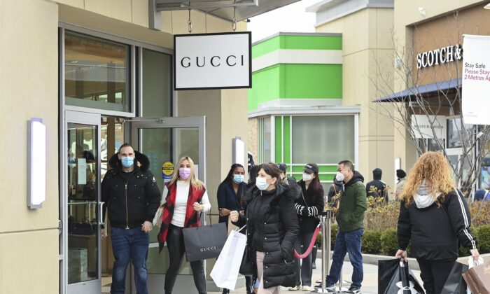 People shop at the Toronto Premium Outlets mall on Black Friday in Milton, Ont.,  on Nov. 27, 2020. (The Canadian Press/Nathan Denette)