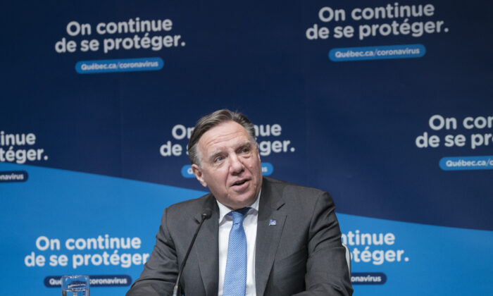 Quebec Premier Francois Legault responds to a question during a news conference in Montreal, Canada, on Dec. 22, 2020. (Paul Chiasson/The Canadian Press)