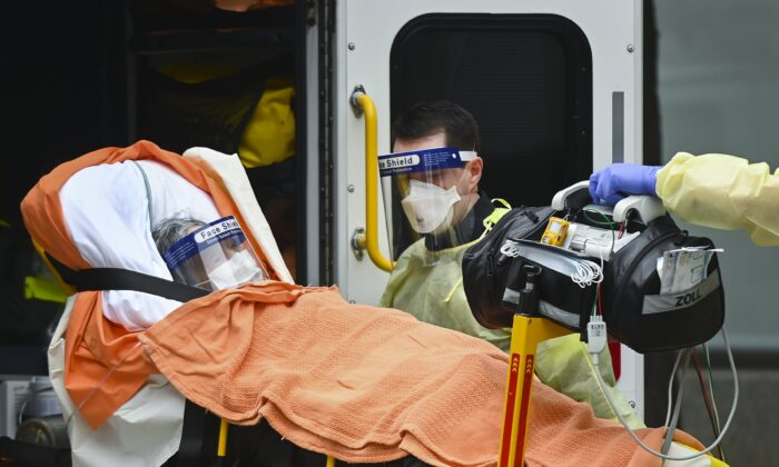Paramedics take away an elderly patient at the Tendercare Living Centre, long-term-care facility during the COVID-19 pandemic in Scarborough, Ont., Canada, on Dec. 23, 2020. (Nathan Denette/The Canadian Press)