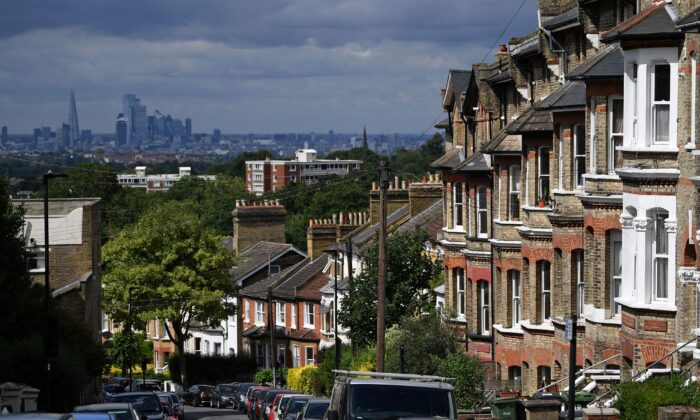 Rows of terraced houses and residential properties are pictured in south London, backdropped by the skyline of the City of London, on July 6, 2020. (Daniel Leal-Olivas/AFP via Getty Images)