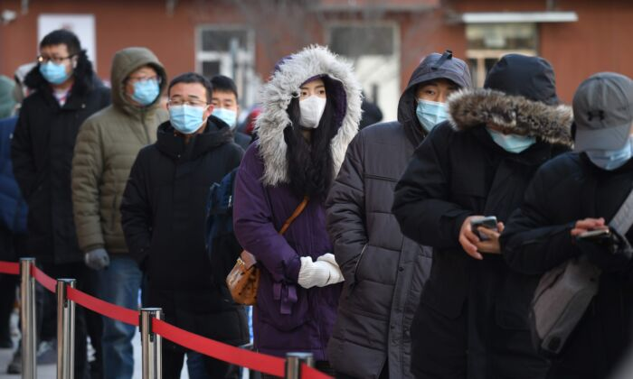 People line up to be tested for the COVID-19 outside a hospital in Beijing, China on Jan. 5, 2021. (GREG BAKER/AFP via Getty Images)