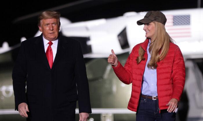 U.S. President Donald Trump arrives with Sen. Kelly Loeffler (R-GA) at a campaign rally at Dalton Regional Airport in Dalton, Ga., on Jan. 4, 2021. (Alex Wong/Getty Images)
