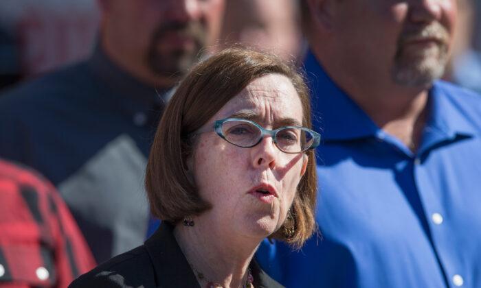 Oregon Gov. Kate Brown speaks to the press in Roseburg, Ore. on Oct. 2, 2015.  (Scott Olson/Getty Images)