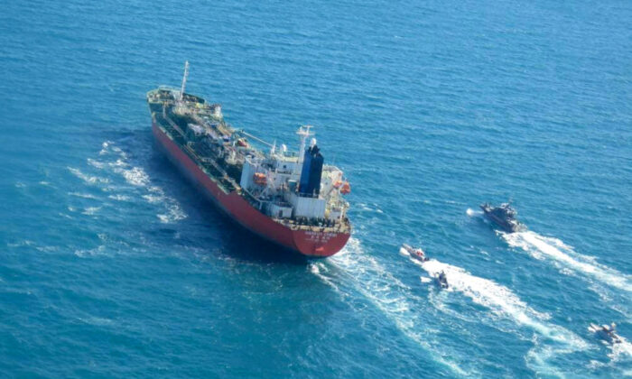 A picture shows the South Korean-flagged tanker being escorted by Iran's Revolutionary Guards navy after being seized in the Gulf. (Tasnim News/AFP via Getty Images)