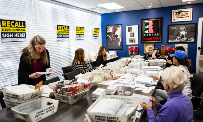 Volunteers sort recall mail, hoping to oust California Gov. Gavin Newsom at Capital Campaigns Inc. in Newport Beach, Calif., on Jan 4, 2021. (John Fredricks/The Epoch Times)