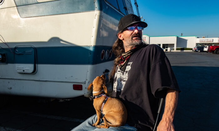 William Abercrombie parks his RV, which is his home, in a mini-mall parking area in Fullerton, Calif., on Dec. 10, 2020. (John Fredricks/The Epoch Times)