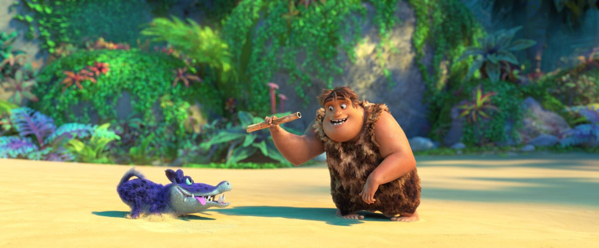 "cave boy plays with dog in ""The Croods: A New Age"""