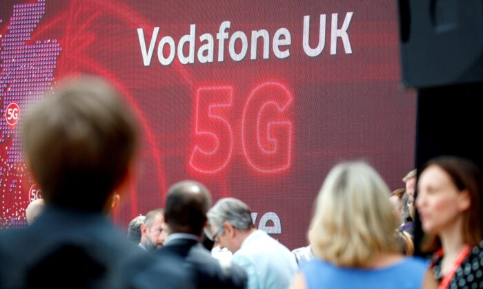 The 5G logo is pictured during the launch of Vodafone UK's 5G mobile data network in London on July 3, 2019. (Tolga Akmen/AFP via Getty Images)