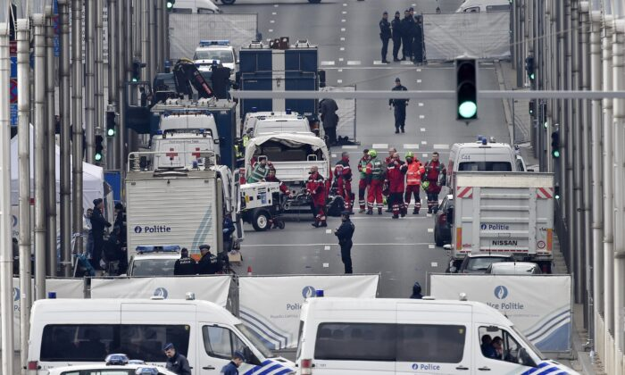 Police and rescue teams are pictured outside the metro station Maelbeek in Brussels, on March 22, 2016. (Martin Meissner/File/AP Photo)
