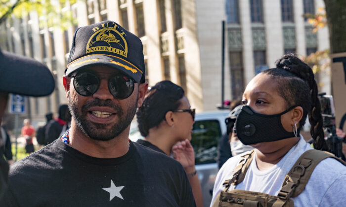 Enrique Tarrio, head of the Proud Boys, is escorted out of the area after arguing with counter-protestors at a 'Stop the Steal' protest outside of the Georgia State Capital building in Atlanta, Ga., on Nov. 21, 2020. (Megan Varner/Getty Images)