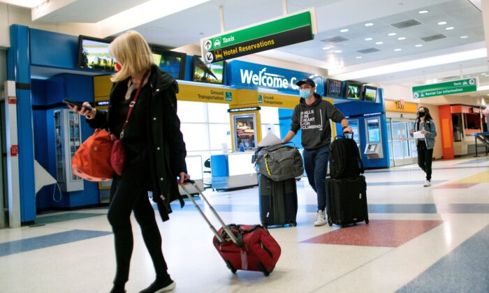 Passengers arrive on a flight from London amid new restrictions to prevent the spread of COVID-19 at JFK International Airport in New York City on Dec. 21, 2020. (Eduardo Munoz/Reuters)