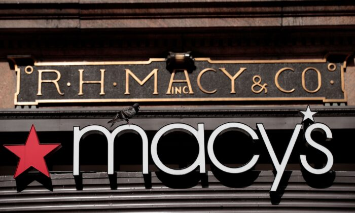 The Macy's sign hangs over its flagship store in Herald Square, in New York City, on Aug. 11, 2016. (Drew Angerer/Getty Images)