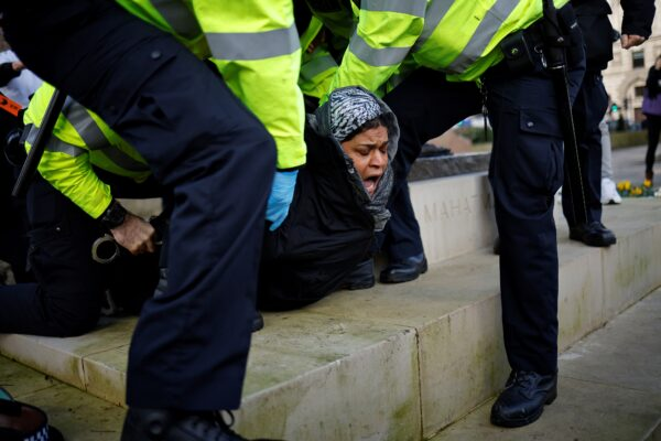UK police arrest virus protesters