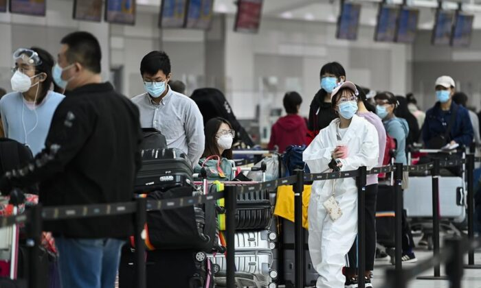 People line up and check in for an international flight at Pearson International airport during the COVID-19 pandemic in Toronto on Oct. 14, 2020. (The Canadian Press/Nathan Denette)