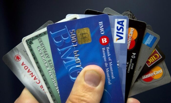 Credit cards are displayed in Montreal, on Dec. 12, 2012. (The Canadian Press/Ryan Remiorz)
