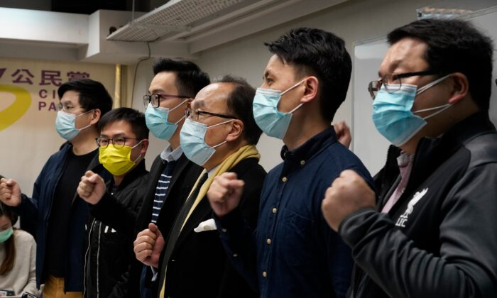 Pro-Democratic Party members shout slogans in response to the mass arrests during a press conference in Hong Kong, on Jan. 6, 2021. (Vincent Yu/AP Photo)
