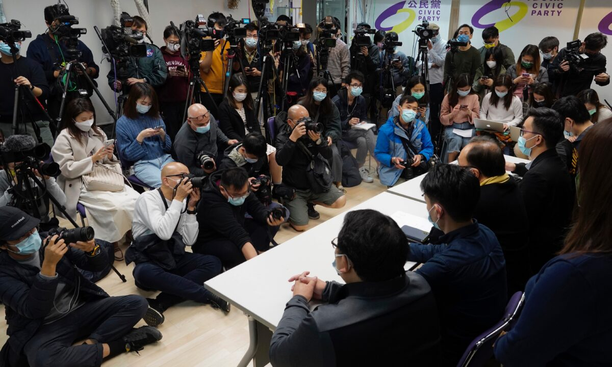 Pro-democratic party members respond to the mass arrests during a press conference