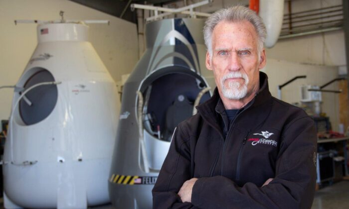 Art Thompson, CEO of Sage Cheshire and president of A2ZFX, stands in front of two model capsules he built for Red Bull Stratos, in a file photo. (Linda KC Reynolds)