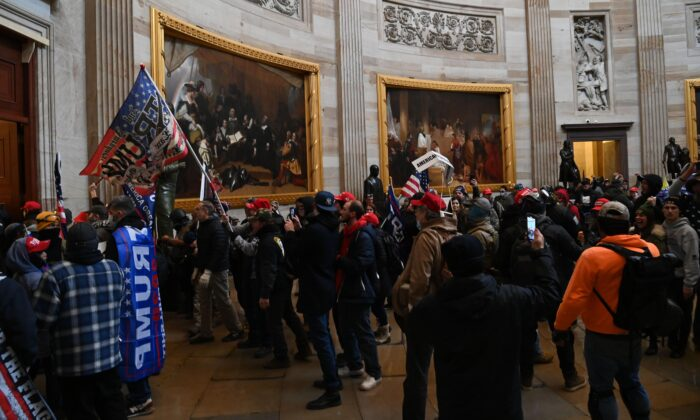 A group of protesters enter the U.S. Capitol's Rotunda in Washington on Jan. 6, 2021. (Saul Loeb/AFP via Getty Images)