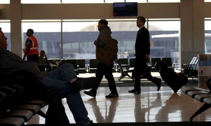 Travelers walk through terminal A at Hartsfield-Jackson Atlanta International Airport, in Atlanta, Ga., on April 20, 2020. (Rob Carr/Getty Images)