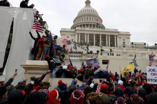 Protesters and rioters gather outside the U.S. Capitol Building