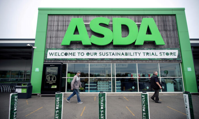 File photo shows shoppers walking past the UK supermarket Asda, in Leeds, Britain, on Oct. 19, 2020. (Reuters/Molly Darlington)