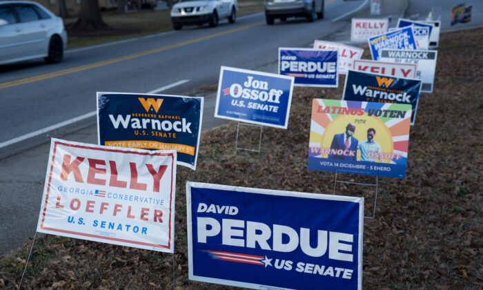 Signs line a road at a Gwinnett County voting location in Atlanta, Georgia, on Jan. 5, 2021. (Megan Varner/Getty Images)