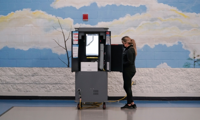 Voters cast their ballots in Georgia's Senate runoff elections at a Fulton County polling station in Atlanta, Ga., on Jan. 5, 2021. (Elijah Nouvelage/Reuters)