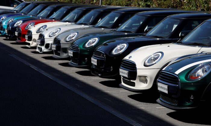 Used and new cars are pictured on the forecourt of a re-opened Mini car dealership, in Hook, southwest of London, on June 1, 2020. (Adrian Dennis/AFP via Getty Images)